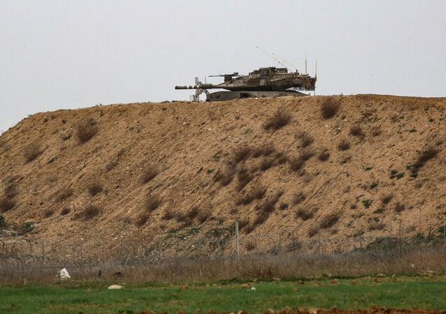 An Israeli tank is pictured on Israel's border with Gaza, opposite the Palestinilan city of Khan Yunis in the southern Gaza Strip, on January 13, 2021.