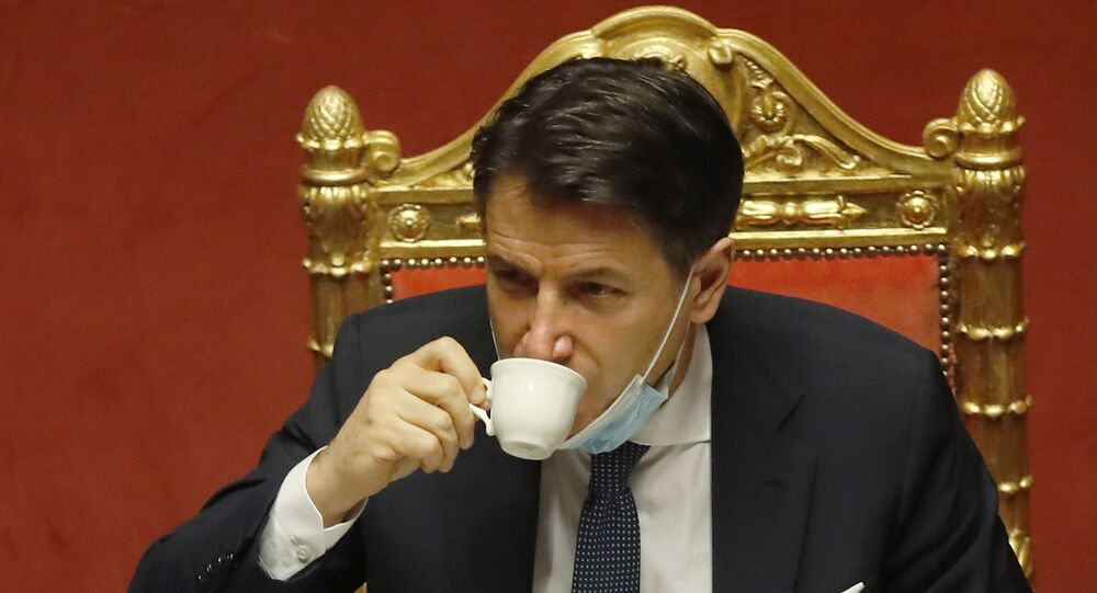 Italian premier Giuseppe Conte sips a coffee during a debate at the Senate prior to a confidence vote, in Rome, Tuesday, Jan. 19, 2021.