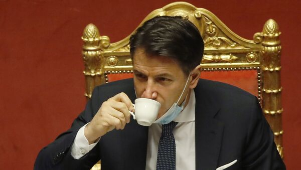 Italian premier Giuseppe Conte sips a coffee during a debate at the Senate prior to a confidence vote, in Rome, Tuesday, Jan. 19, 2021. - Sputnik International
