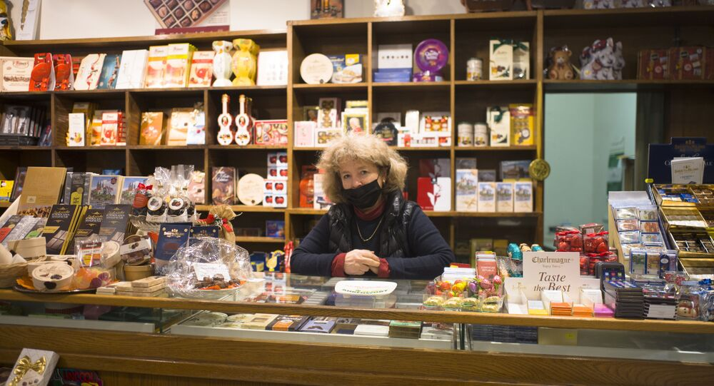 Franziska Schlieter poses for a photo during an interview with the Associated Press inside her gourmet food store in the old city in Meissen, Germany, Monday, Jan. 11, 2021.