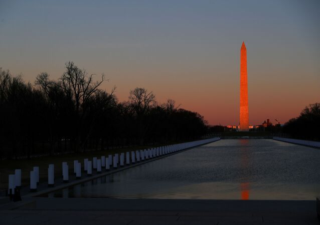 The sun sets on the National Mall ahead of U.S. President-elect Joe Biden's remarks at the Lincoln Memorial in Washington, U.S. January 19, 2021.