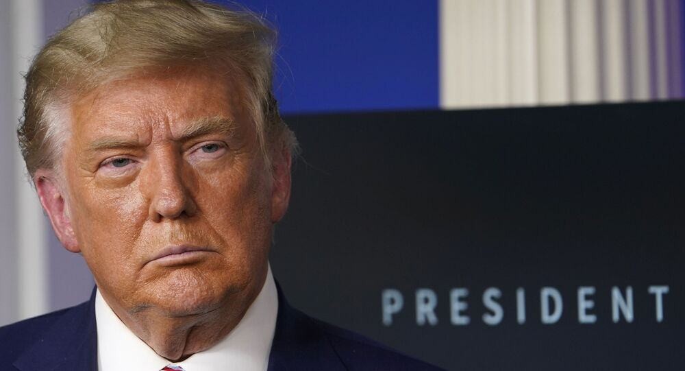 In this Friday, Nov. 20, 2020, file photo, President Donald Trump listens during an event in the briefing room of the White House in Washington.