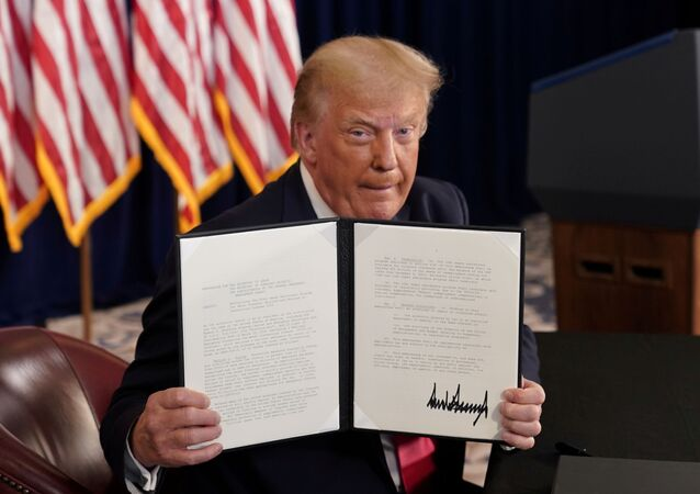 U.S. President Donald Trump shows signed executive orders for economic relief at his golf resort in Bedminster, New Jersey, U.S., August 8, 2020.