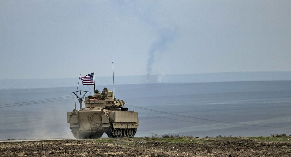 US soldiers in a Bradley tank patrol an area near Syria's north-eastern Semalka border crossing with Iraq's Kurdish autonomous territory, on 12 January 2021.