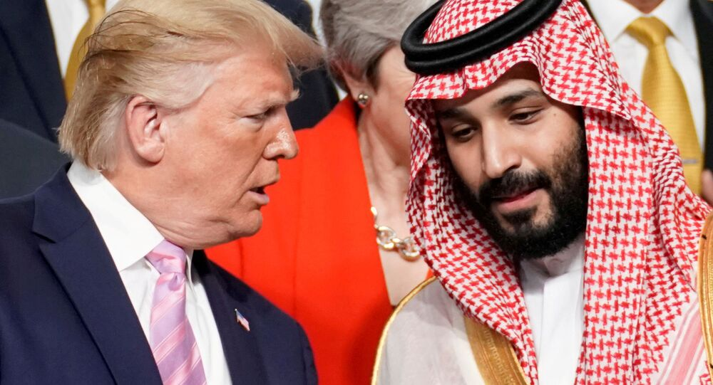 U.S. President Donald Trump speaks with Saudi Arabia's Crown Prince Mohammed bin Salman during family photo session with other leaders and attendees at the G20 leaders summit in Osaka, Japan, June 28, 2019.