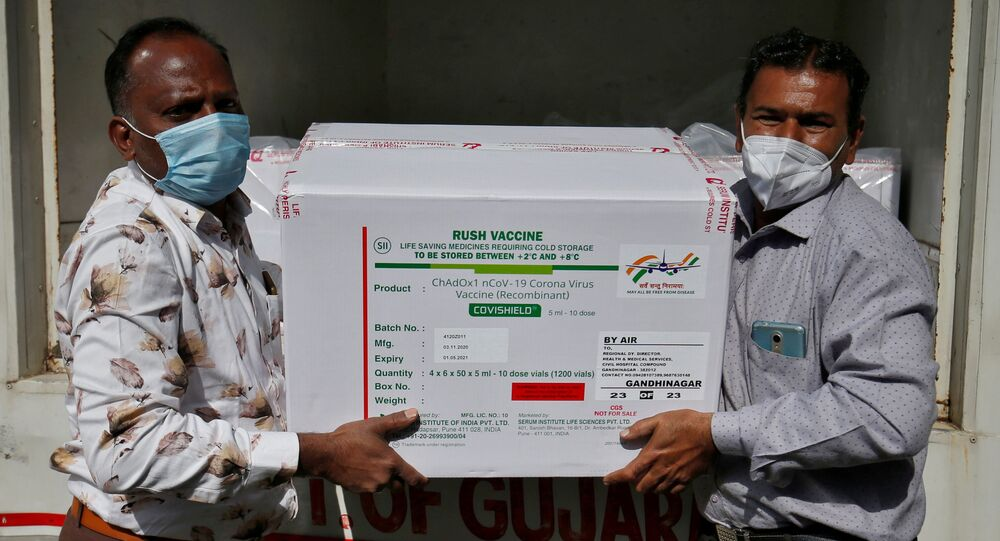 Officials unload boxes containing vials of COVISHIELD, a coronavirus disease (COVID-19) vaccine manufactured by Serum Institute of India, after a consignment of the vaccines arrived from the western city of Pune for its distribution, outside a vaccination storage centre in Ahmedabad, India, January 12, 2021.