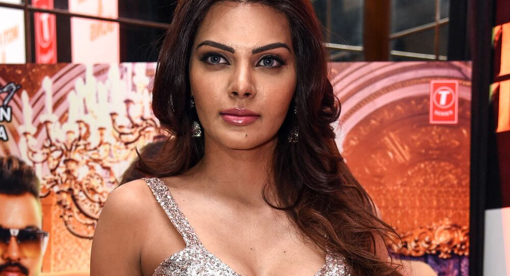 Indian Bollywood producer, actress and model Sherlyn Chopra poses for photographs during the launch of her new single clip 'Tunu Tunu' in Mumbai on January 22, 2019