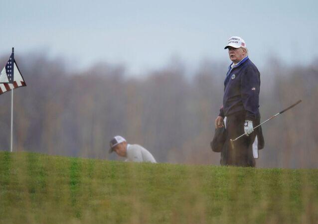 U.S. President Donald Trump plays golf at the Trump National Golf Club in Sterling, Virginia, U.S., November 15, 2020