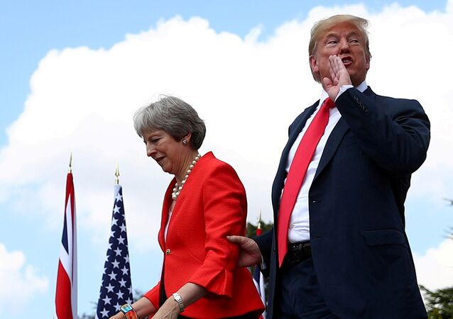 Britain's Prime Minister Theresa May and U.S. President Donald Trump walk away after holding a joint news conference at Chequers, the official country residence of the Prime Minister, near Aylesbury, Britain, July 13, 2018