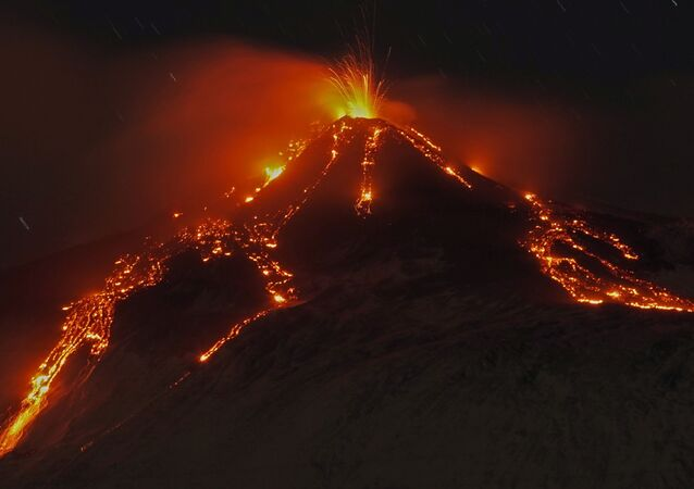 An eruption from Mount Etna lights up the sky during the night, seen from the small village of Fornazzo, under the volcano, Italy, January 19, 2021