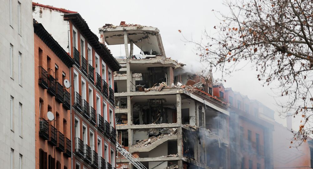 Smoke rises from a damaged building after an explosion in downtown Madrid, Spain, 20 January 2021.