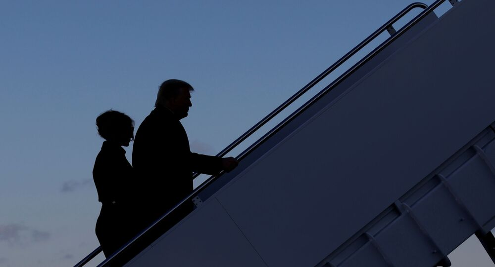 U.S. President Donald Trump departs next to first lady Melania Trump from the Joint Base Andrews, Maryland, U.S., January 20, 2021.