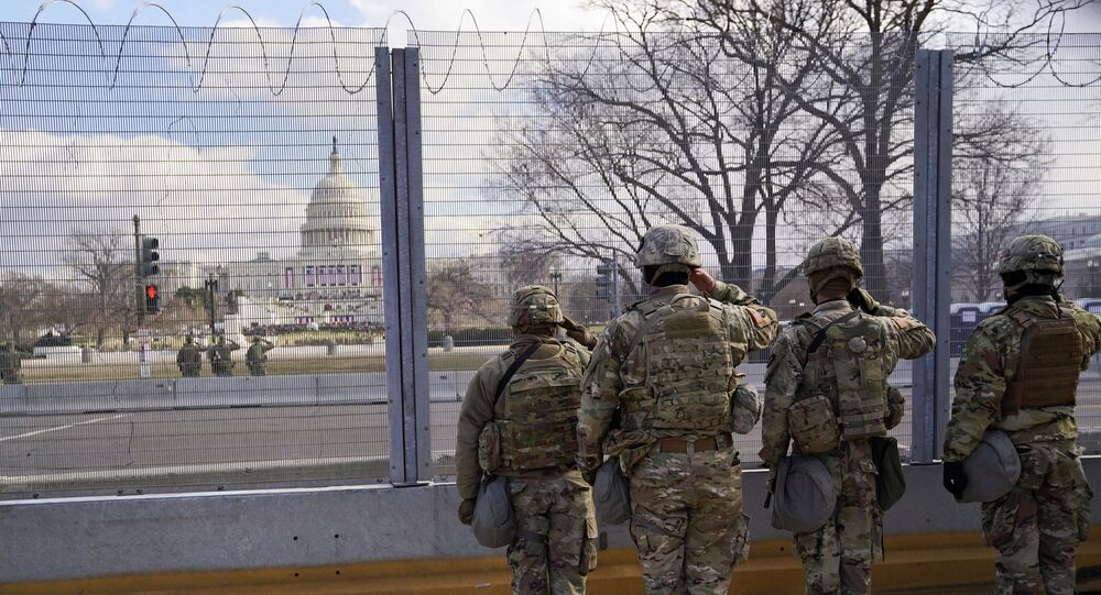 National Guard members salute in front of the U.S. Capitol building during the inauguration of President-elect Joe Biden in Washington, U.S., January 20, 2021. REUTERS/Allison Shelley