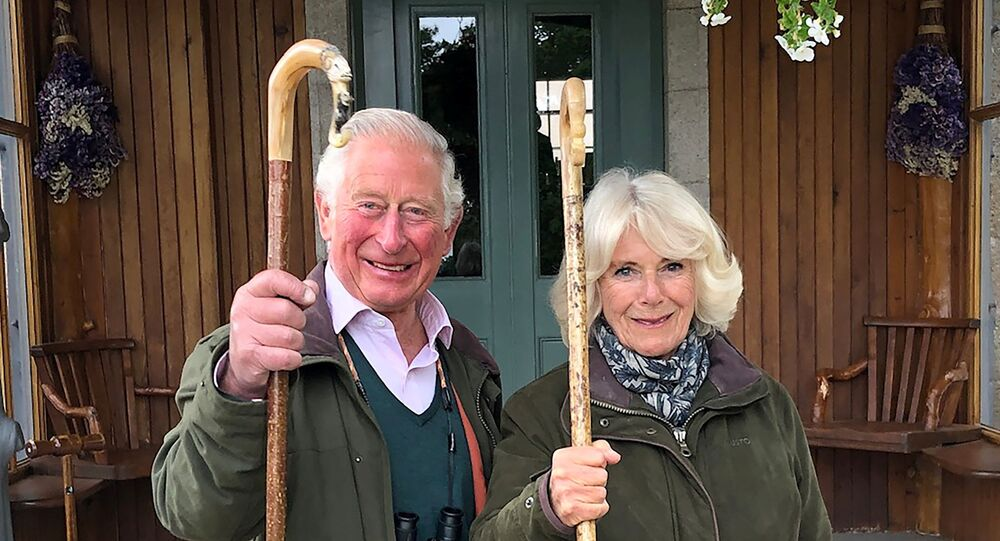 Britain's Prince Charles, Prince of Wales and Camilla, Duchess of Cornwall holding shepherd's crooks pose for a photo at Birkhall on the Balmoral Estate, in Scotland, Britain