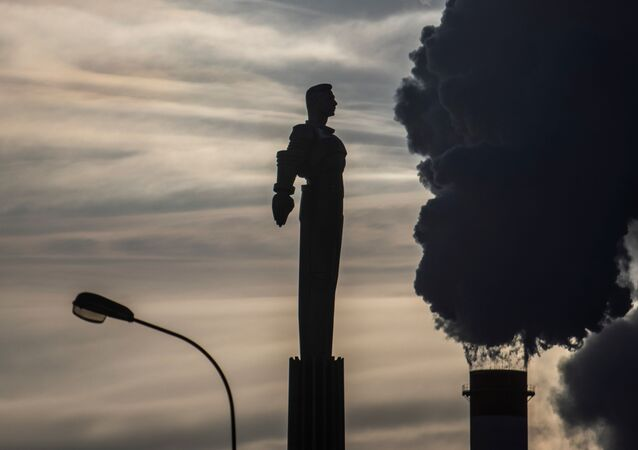 Steam rises from chimneys of a heating power plant near a monument of Soviet cosmonaut Yuri Gagarin, the first man in space, with the air temperature at about minus 20 degrees Celsius, in Moscow, Russia, January 17, 2021