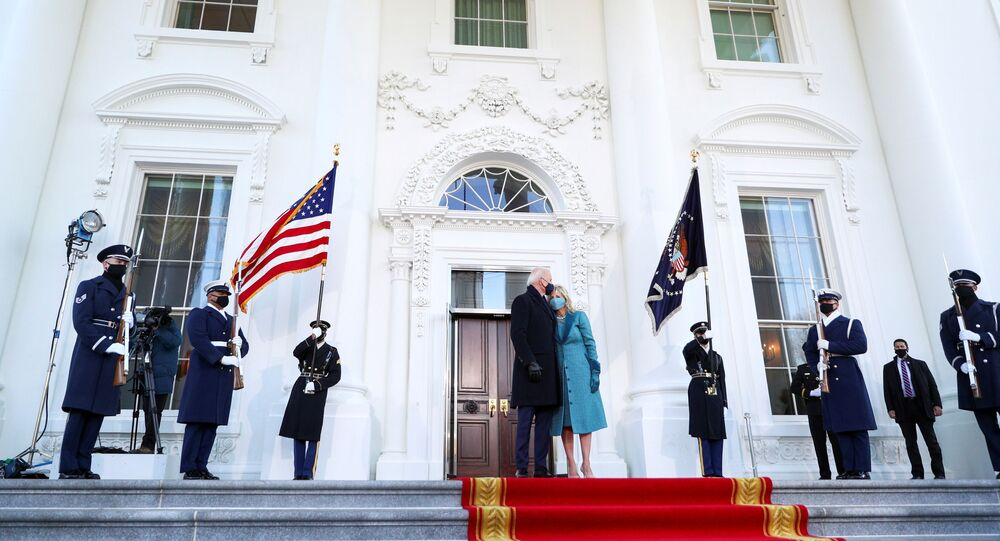 US President Joe Biden kisses first lady Jill Biden as they stand at the North Portico of the White House, in Washington, DC, 20 January 2021.