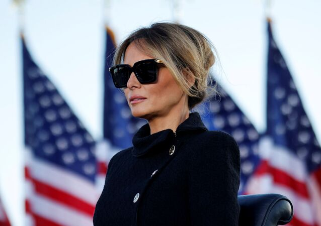 Former first lady Melania Trump listens as her husband delivers remarks during his last speech as president at Joint Base Andrews, Prince George's County, Maryland, US, 20 January 2021.