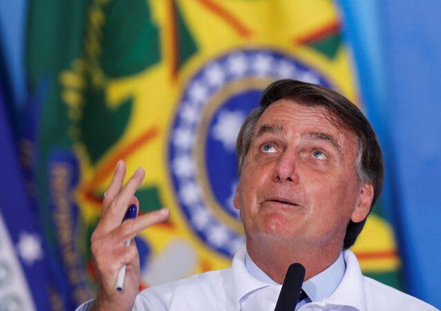 Brazil's President Jair Bolsonaro speaks during a ceremony at the Planalto Palace in Brasilia, Brazil January 12, 2021.