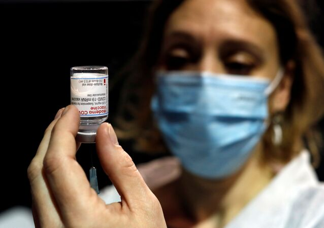 A health worker prepares a syringe with the Moderna coronavirus disease (COVID-19) vaccine at a vaccination center in Le Cannet, France, January 19, 2021