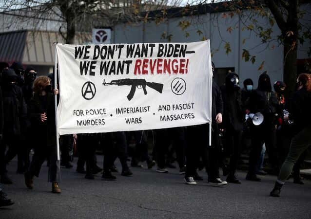 Activists take part in a protest after the inauguration of U.S. President Joe Biden, in Portland, Oregon, U.S. January 20, 2021.