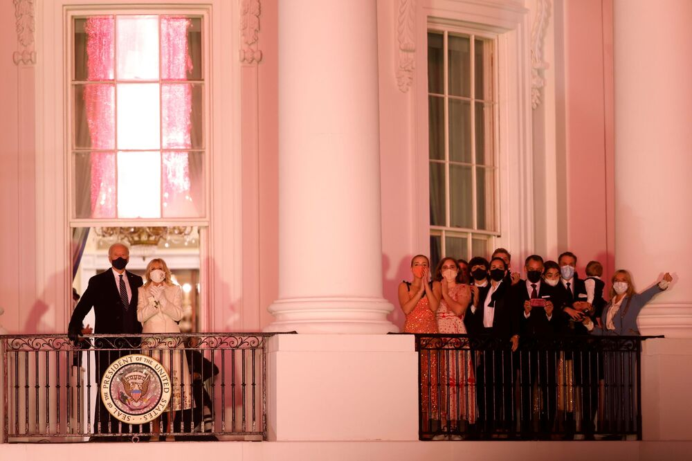 US President Joe Biden and First Lady Dr Jill Biden watch a fireworks display beside family and staff members from the Truman Balcony of the White House in Washington, DC, US, 20 January 2021.
