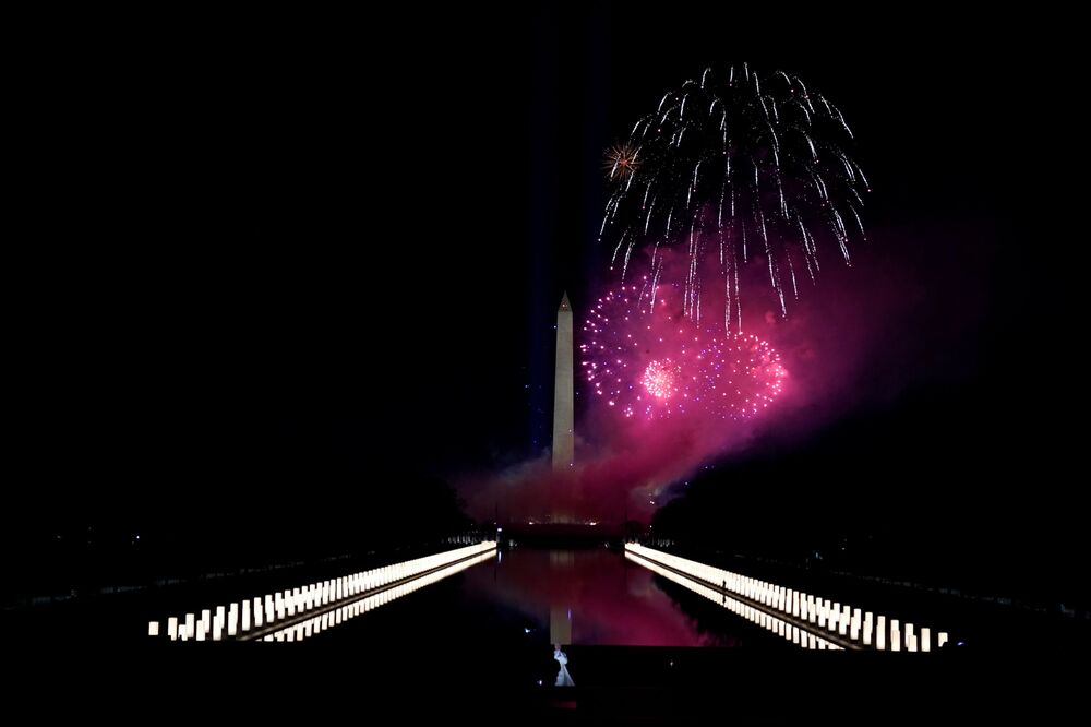 Katy Perry (foreground) performs in front of a firework display during the Celebrating America event at the Lincoln Memorial after the inauguration of Joe Biden as the 46th president of the United States in Washington, DC, US, 20 January 2021.