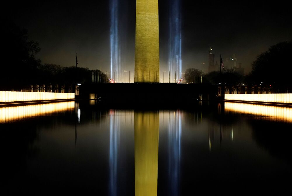 The Washington Monument is reflected in the Lincoln Memorial Reflecting Pool during the Celebrating America event at the Lincoln Memorial after the inauguration of Joe Biden as the 46th president of the United States in Washington, DC, US, 20 January 2021.