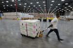 FILE PHOTO: Boxes containing the Moderna COVID-19 vaccine are prepared to be shipped at the McKesson distribution center in Olive Branch, Mississippi, U.S. December 20, 2020