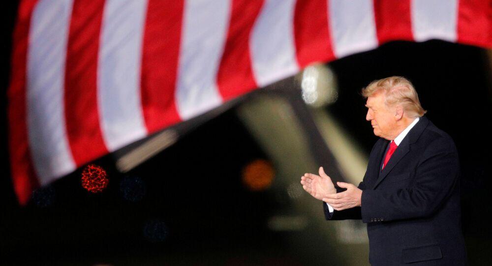 U.S. President Donald Trump applauds as he campaigns with  Republican U.S. Senator Kelly Loeffler  on the eve of Georgia's run-off election in Dalton, Georgia, U.S., January 4, 2021