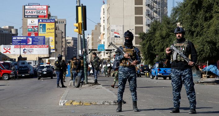 Members of Iraqi security forces keep guard at the site of a twin suicide bombing attack in a central market in Baghdad, Iraq January 21, 2021