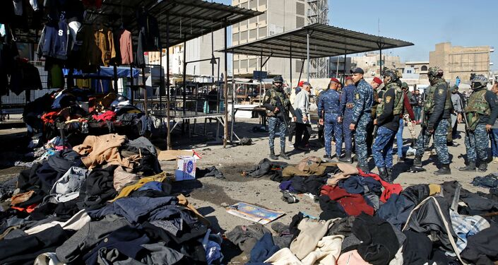 Members of Iraqi security forces gather at the site of a twin suicide bombing attack in a central market in Baghdad, Iraq January 21, 2021.