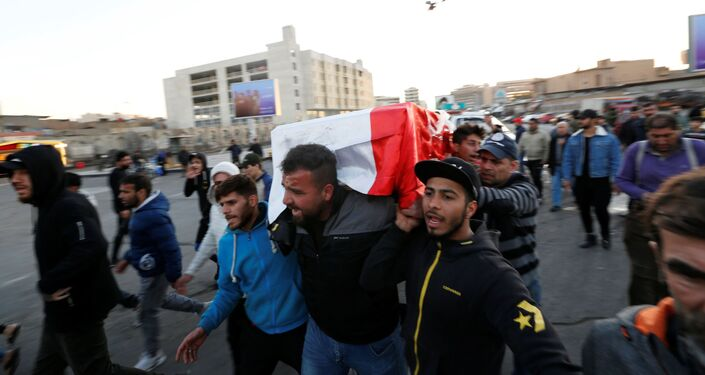 Mourners carry the coffin of a man who was killed in a twin suicide bombing attack in a central Baghdad market, during his funeral in Baghdad, Iraq January 21, 2021.