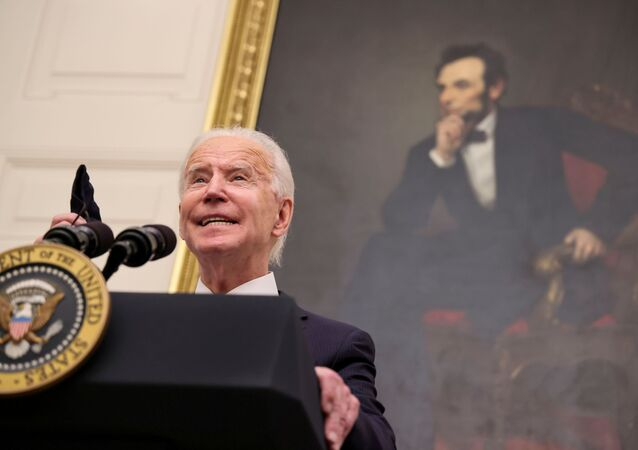 FILE PHOTO: With a portrait of former President Abraham Lincoln hanging in the background, U.S. President Joe Biden speaks about his administration's plans to fight the coronavirus disease (COVID-19) pandemic during a COVID-19 response event at the White House in Washington, DC, 21 January 2021.