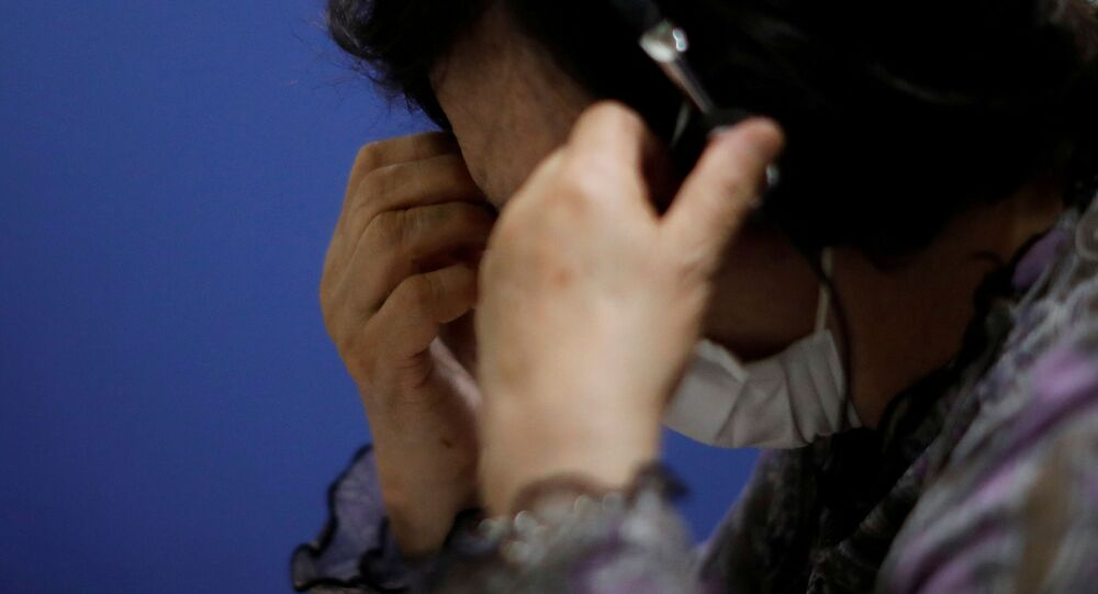 A volunteer responds an incoming call at the Tokyo Befrienders call centre, a Tokyo suicide hotline centre, during the spread of the coronavirus disease (COVID-19), in Tokyo, Japan, 26 May 2020.