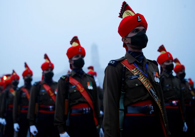 Army soldiers take part in the rehearsal for the Republic Day parade, in New Delhi, India January 18, 2021