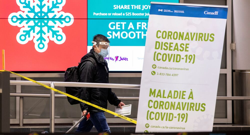 A man walks through terminal 3, amid a spike in coronavirus disease (COVID-19) cases, at Pearson airport near Toronto, Ontario, Canada December 30, 2020.