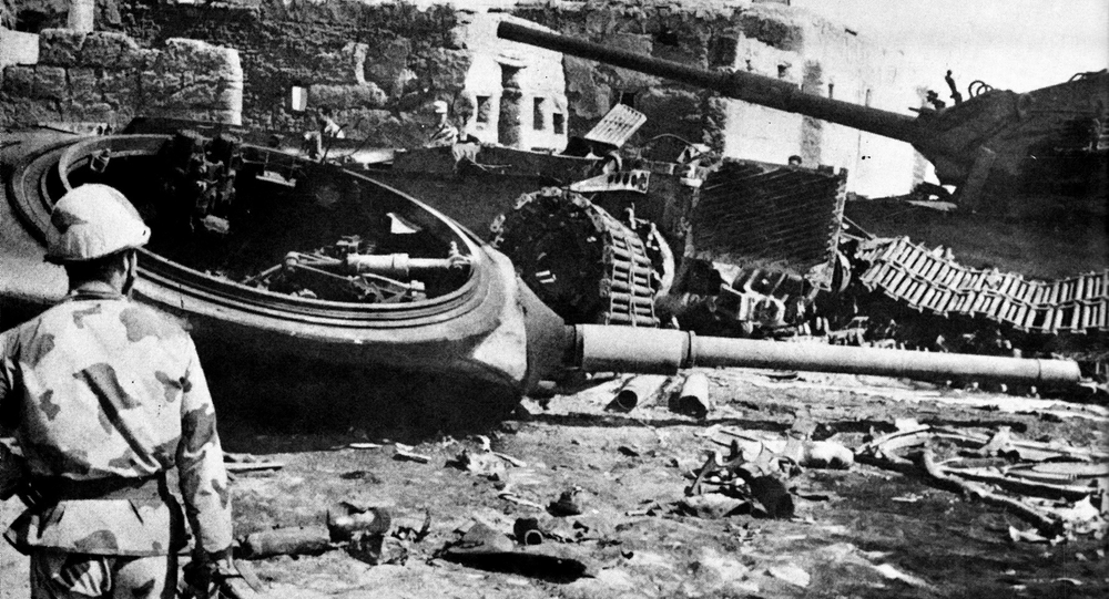 An Egyptian Sa'iqa (commando) before a group of knocked out Israeli tanks, in the village of Abu 'Atwa, during the Battle of Ismailia, Yom Kippur War.