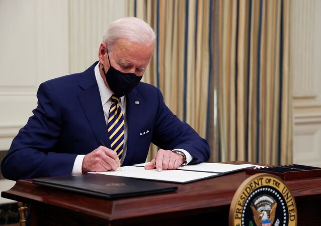 U.S. President Joe Biden and signs an executive order after speaking about his administration's plans to respond to the economic crisis during a coronavirus disease (COVID-19) response event in the State Dining Room at the White House in Washington, U.S., January 22, 2021.