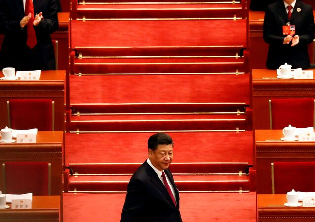 Chinese President Xi Jinping arrives for the opening session of the National People's Congress (NPC) at the Great Hall of the People in Beijing, China March 5, 2018.