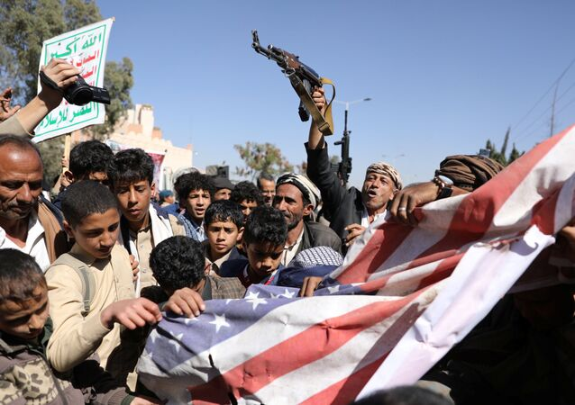 Houthi supporters shatter the U.S. flag during a demonstration outside the U.S. embassy against the United States over its decision to designate the Houthis a foreign terrorist organisation, in Sanaa, Yemen January 18, 2021.