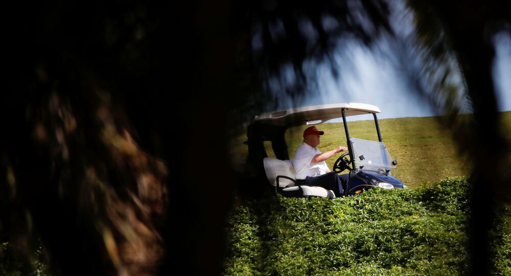 U.S. President Donald Trump plays golf at the Trump International Golf Club in West Palm Beach Florida U.S