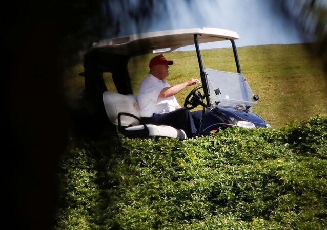 U.S. President Donald Trump plays golf at the Trump International Golf Club in West Palm Beach, Florida, U.S., December 28, 2020.
