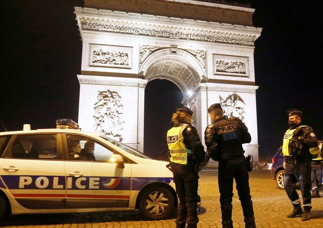 French police patrol in front of Arc de Triomphe on the Champs Elysees
