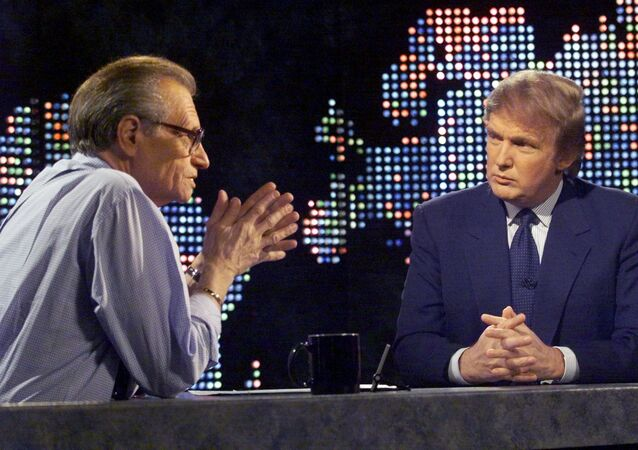 Billionaire real estate developer Donald Trump (R) talks with host Larry King after taping a segment of King's CNN talk show, in New York, U.S., October 7, 1999.