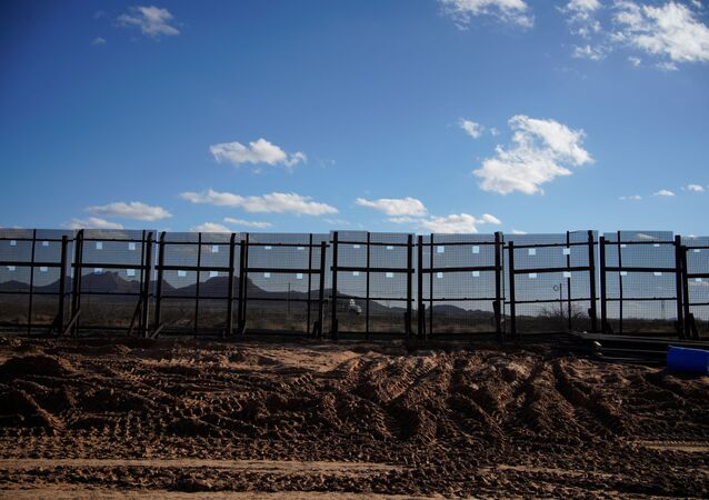 A segment of the border wall under construction is seen abandoned after US President Joe Biden signed an executive order halting construction of the US-Mexico border wall, in Sunland Park, New Mexico, US, 22 January 2021.