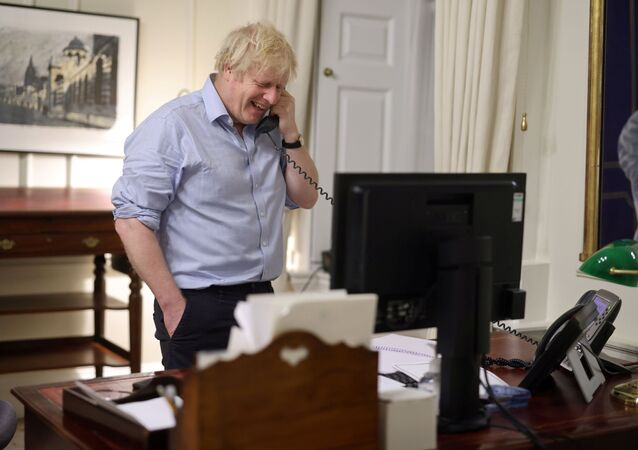 British Prime Minister Boris Johnson speaks to U.S. President Joe Biden from London, Britain in this social media image obtained on January 23, 2021.