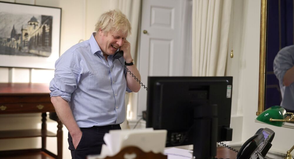 British Prime Minister Boris Johnson speaks to U.S. President Joe Biden from London, Britain in this social media image obtained on January 23, 2021.