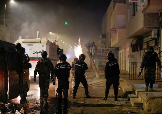 Security forces clash with demonstrators during anti-government protests in Tunis, Tunisia, January 18, 2021.