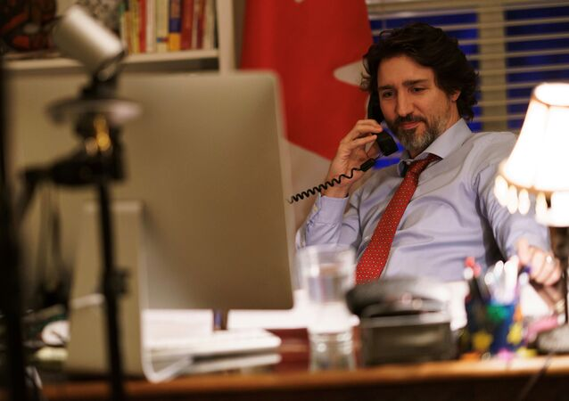 Canada's Prime Minister Justin Trudeau speaks on the phone with U.S. President Joe Biden, who made the first call to a foreign leader following his inauguration, in Ottawa, Ontario, Canada January 22, 2021.