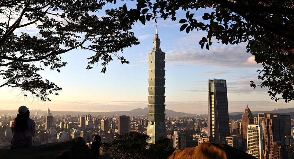 People take photos with Taiwan's landmark building Taipei 101 in the background ahead of the Chinese New Year in Taipei, Taiwan, 20 January 2021.